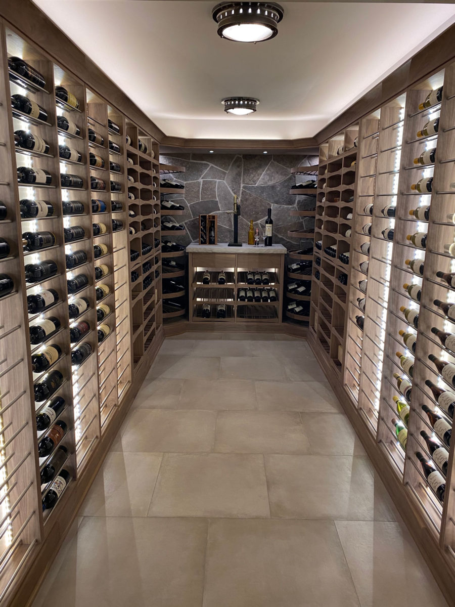 wine cellar with full height wine ladders and pullouts